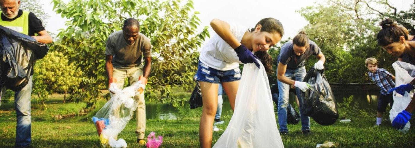people volunteering picking garbage